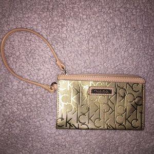 Metallic Gold Calvin Klein Wristlet
